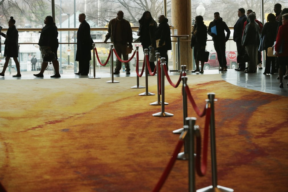 job seekers waiting in line