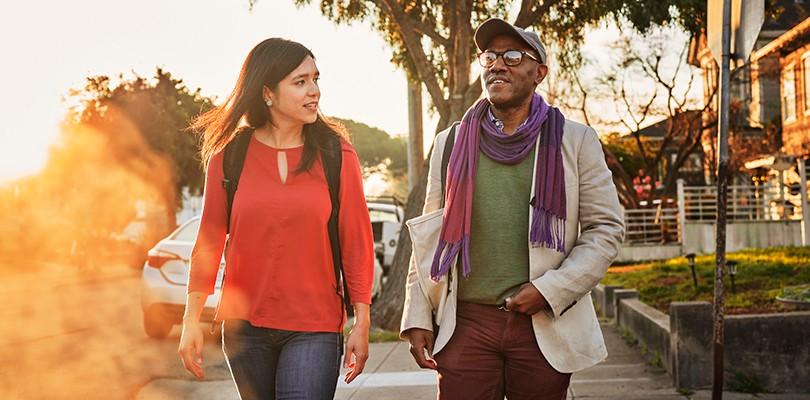 Man and woman walking in a neighborhood