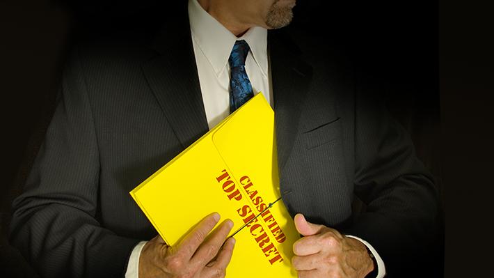 A Businessman Stashes a Top Secret Document in His Suit