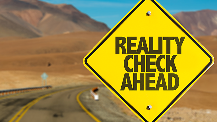reality-check-ahead-yellow-road-sign
