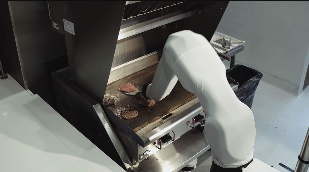 Screenshot from HBO Vice documentary of Flippy the robot flipping hamburgers.