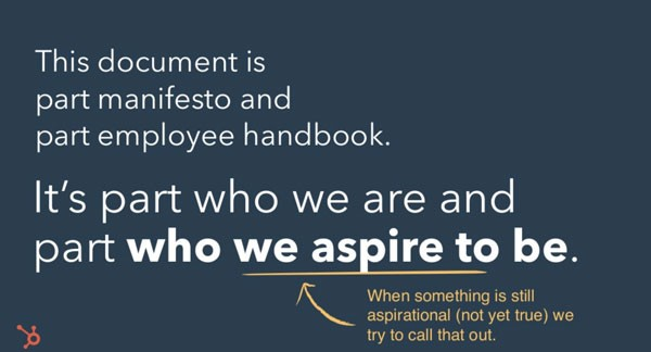 "Screenshot of slide from presentation about HubSpot's Culture Code. Slide reads:  ""This document is part manifesto and part employee handbook. It's part who we are and part who we aspire to be.""  ""We aspire to be"" is underlined and there's an arrow pointing to it with text that reads: ""When something is still aspirational (not yet true) we try to call that out."""