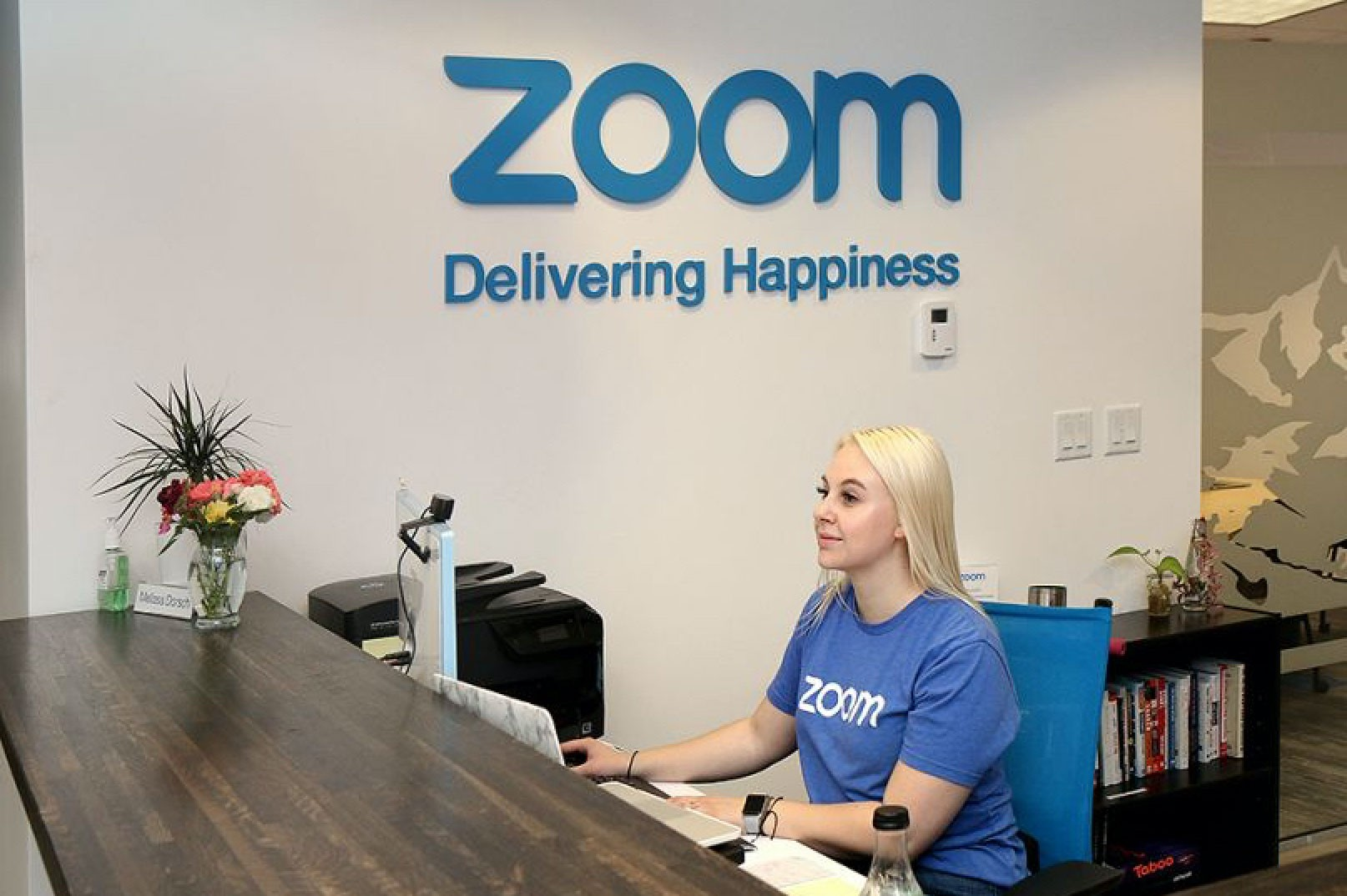 "Photo of Zoom ""Happy Crew"" member sitting at desk"