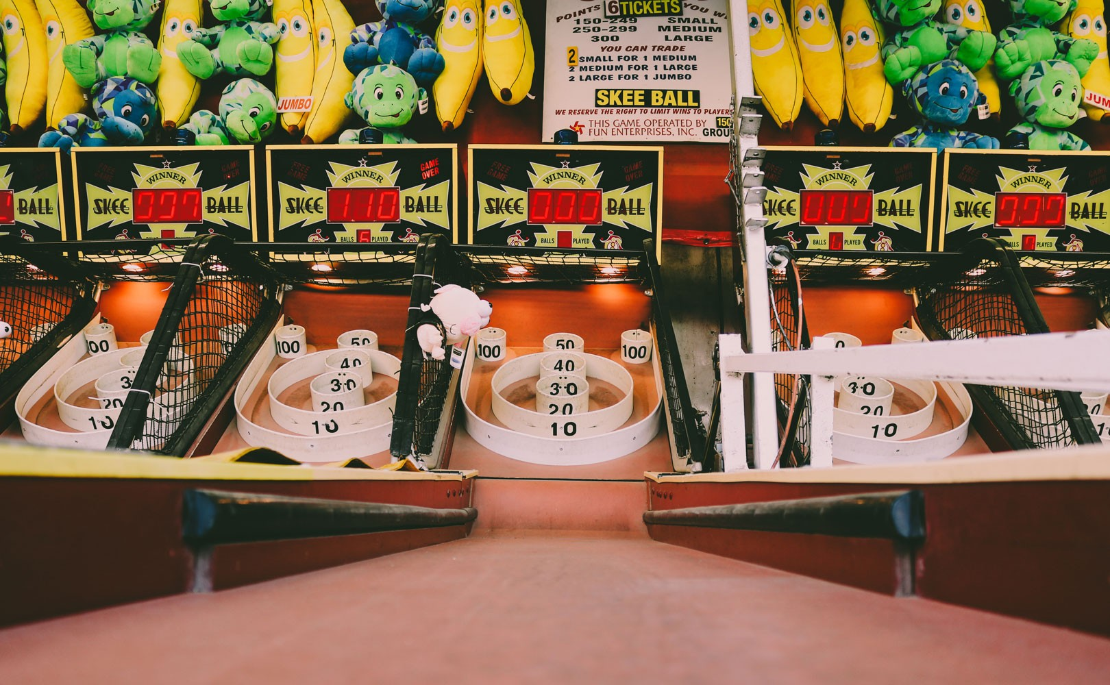 Photo of skeeball game with prizes hanging above