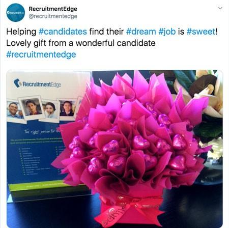 Screenshot of tweet from @recruitmentedge with photo of a chocolate bouquet:  Helping #candidates find their #dream #job is #sweet! Lovely gift from a wonderful candidate #recruitmentedge