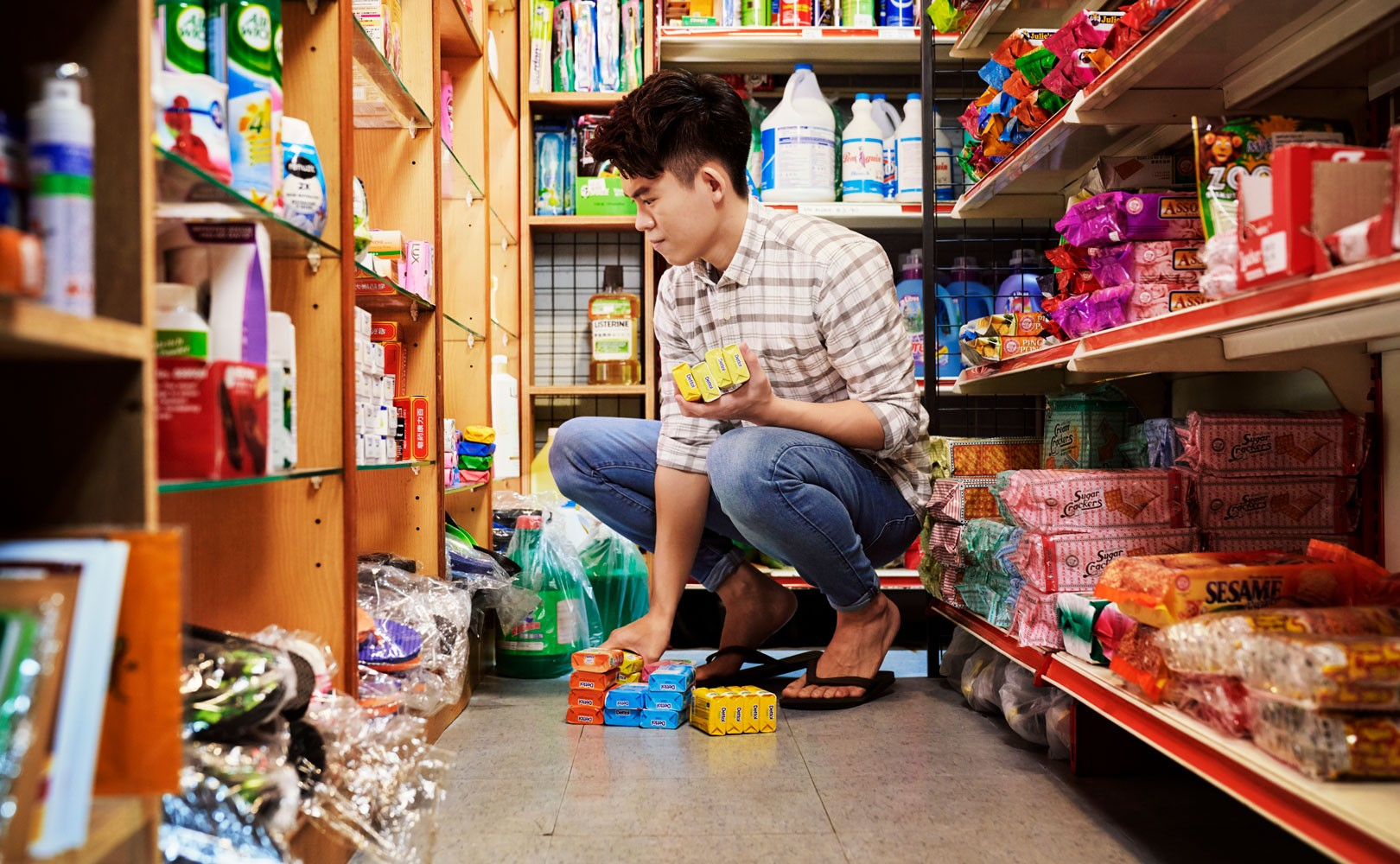 Photo of man stocking shelves in grocery store