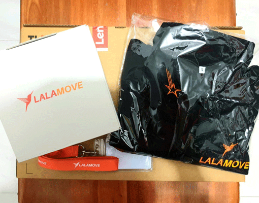 Photograph of swag sent to new Lalamove employees, including a sweatshirt and mystery box.