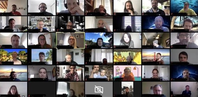 Screenshot of Zoom video of employees listening to a song during 5-minute music break