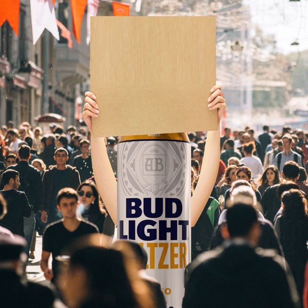 bud light seltzer can with human arms holding a blank sign