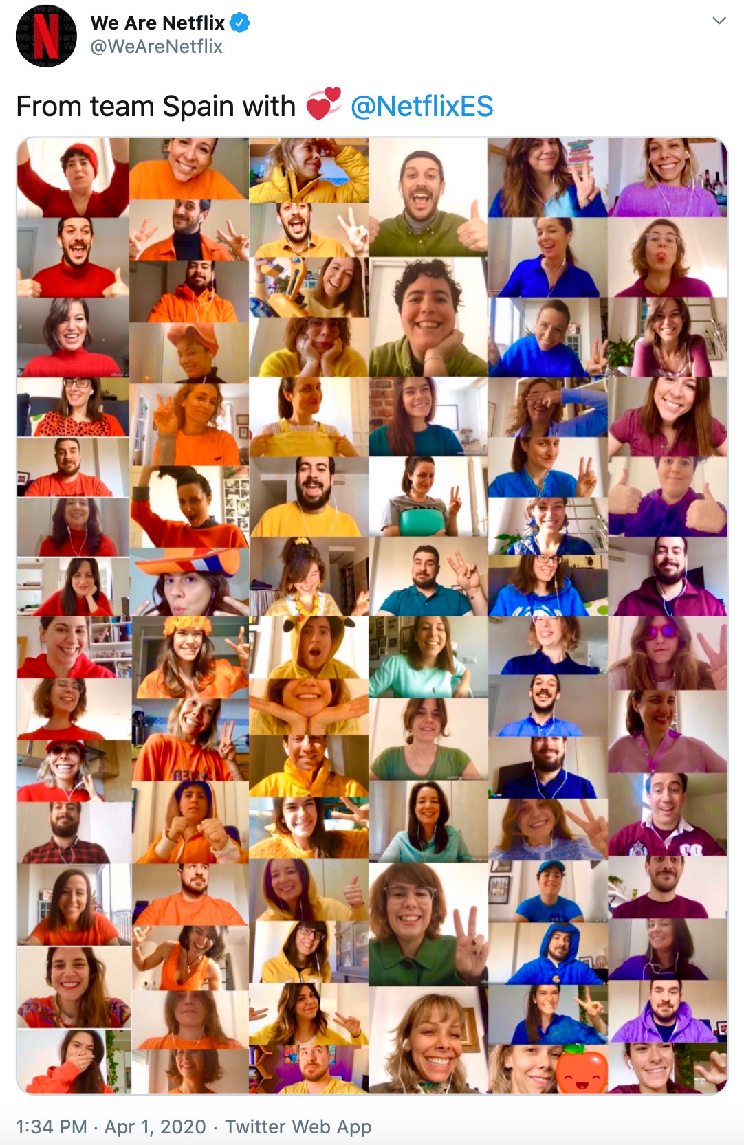 Caption: from team Spain with love. Image: Team members wearing all different colors in order to look like a rainbow.