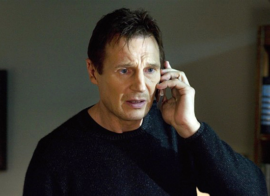 Liam Neeson on a cell phone