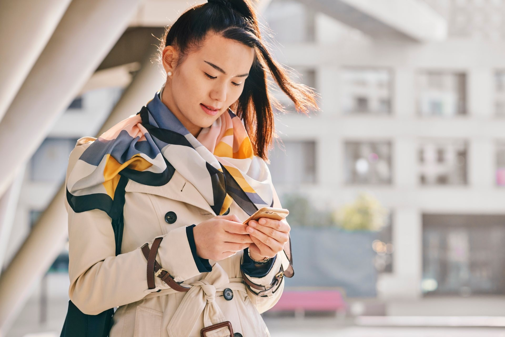 woman walking looking at phone